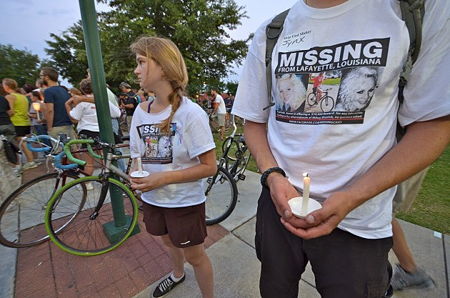 two lafayette residents hold candles at candlelight vigil for mickey shunick