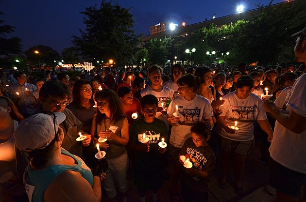 members of the lafayette community attend candlelight vigil for mickey shunick