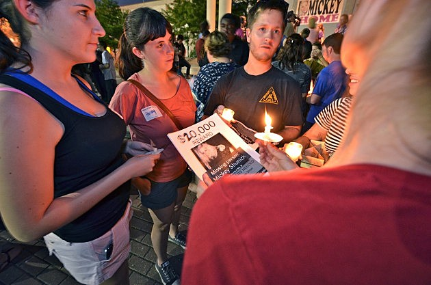 friends of mickey shunick attend candlelight vigil