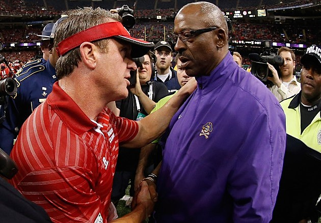 ragin cajuns head coach mark hudspeth congratulates ecu head coach ruffin mcneill after the new orleans bowl