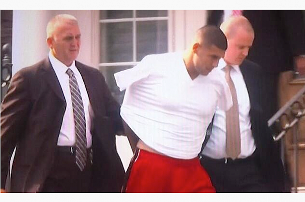 aaron hernandez arrested taken into police custody outside of his home