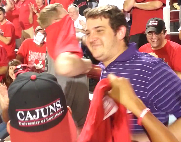 ul fans get lsu fans to switch shirts at baseball game