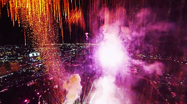 drone flying through fireworks